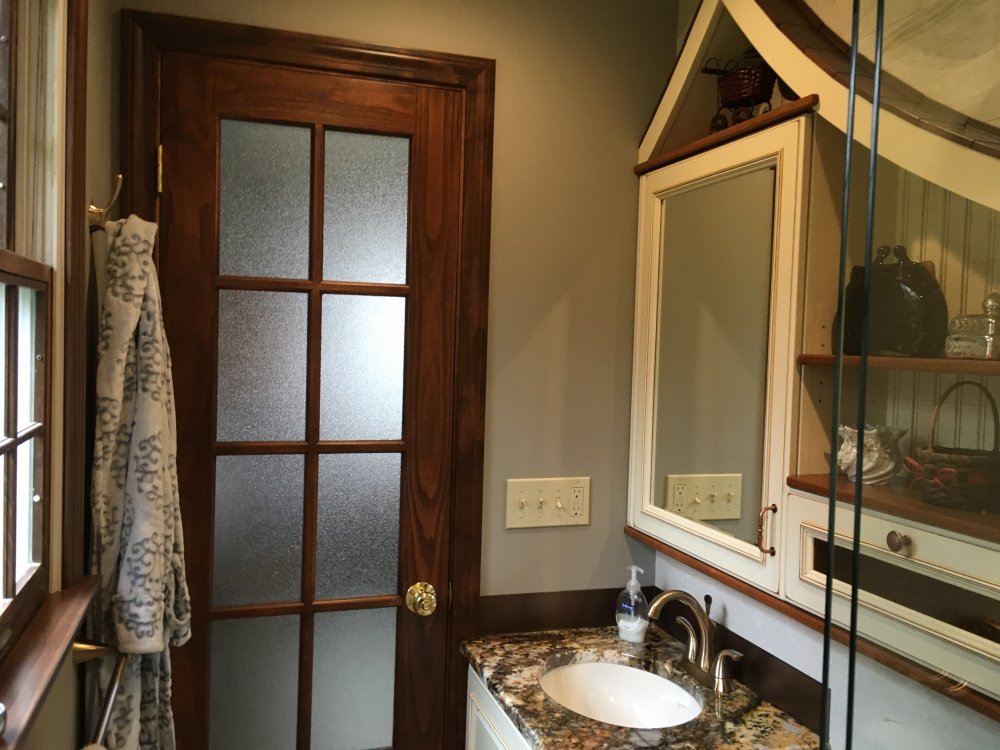 This 'fairy tale' medicine cabinet was custom designed for a small master bath remodel. It was custom crafted by one of our skilled finish carpenters.